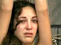 Charming brunette is tied and moreover made to cry by older slave master