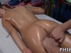 Oily brunette babe gets destroyed on massage table