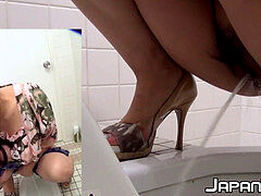 Japanese chick with hairy snatch pees in a public rest room