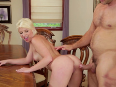 A short haired blonde is pressed against the desk and furthermore penetrated