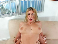 Inviting blondy Sara Stone enjoys riding on a long erect fuck tool