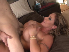 A blonde that has big bra buddies is getting her tight ass pounded