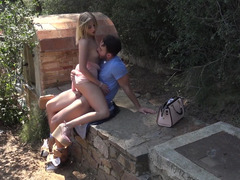 A blonde with is in the garden and moreover she is getting a dick in her mouth