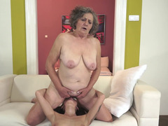 Brunette floozy with a inked body gets freaky with a nasty granny