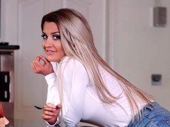 A blonde that loves to pose is playing with her dripping wet vag