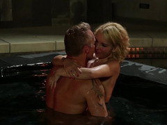 A blonde with undersized breasts is kissed and besides fucked in the pool