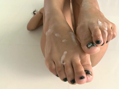 Top heavy babe with a feet fetish gets tons of semen on her legs