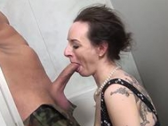 A slim tramp is getting screwed in the public toilet by a stud with a long pecker