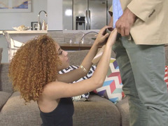 A redhead ebony babe with curly hair is fucked doggy style