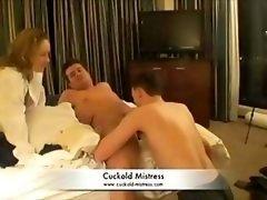 Dominatrix makes lad give head