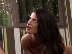 A 18-19 y.o. brunette with an amazing smile is getting her hands on a fuck pole