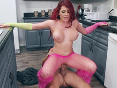 A redhead with large tits is opening up her wet pussy for a cock