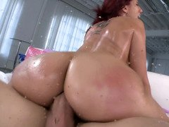 Redhead has a ton of oil on her body to make her considerably more slippery