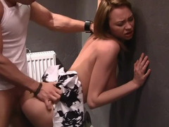 A pair of dudes are having their way with a hot brunette in the toilet