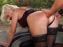 Granny fucked by redneck on immense tire