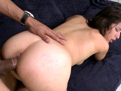 Teenage with large tits is giving a blow job to a large dudes cock