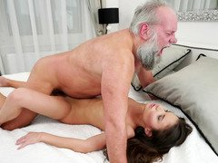 A bimbo that loves old fellas is fucked on the bed deeply