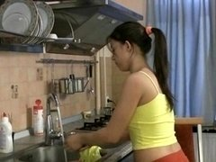 Beautiful broad gives head and besides makes love in the kitchen