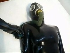 The first Lesson For the first time she wears a latex catsuit with mask & a gasmask with tube