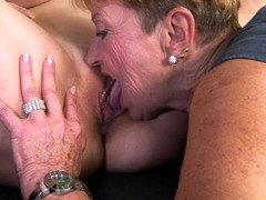 Granny plays with a hot model that has large natural jugs
