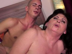 A hot granny is placing her mouth on a youthful and besides hard phallus
