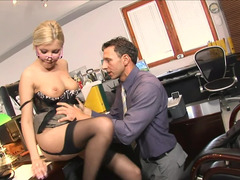 A woman is getting penetrated in the office by her sizeable boss