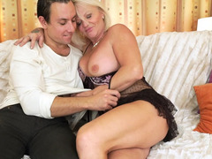 Granny that loves cum cannon is with a young fella, blowing off his hard phallus