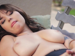 Big-boobied brunette is playing with herself outdoors