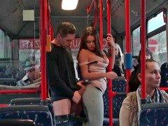 Hot brunette is having sex on the bus in public