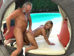A grandpa that loves young-looking pussy is having an intercourse a hot blonde bitch