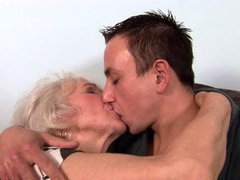A weighty granny is getting fucked by a shorty haired lad on the sofa