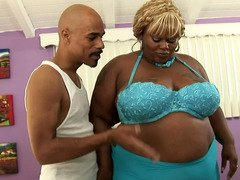 A black lady that has a weighty body is sucking a big meaty pecker