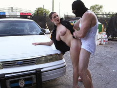 Big dude is pushing his phallus into a sexy cop with large tits