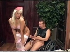 Nurse Nikki getting down and dirty a gimp in boots and stockings