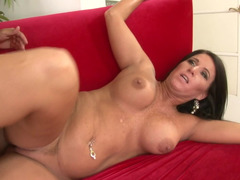 A hot cougar is getting her ass stretched wide open on the sofa