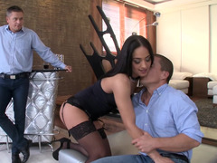 Beautiful dark haired Hungarian temptress takes a couple of big peckers