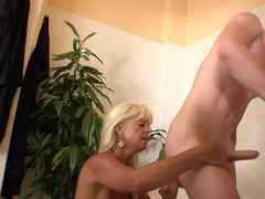 Blonde that has a hot face is giving head a sizeable hard cock