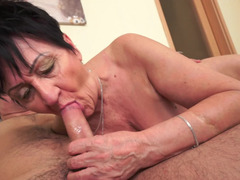 Granny places her mouth on a long and besides beefy hard big pole