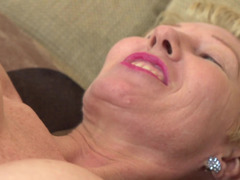 A hot granny is by herself, playing with her sensitive snatch