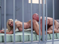 A blonde cutie pie is getting fucked really hard in the prison