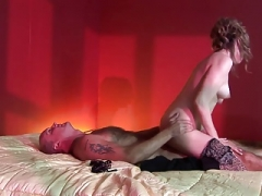 Passionate doll swallows a bulky purple rod down her throat in a reality shoot