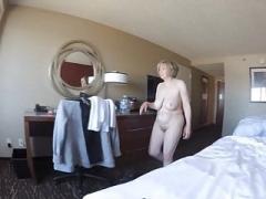 Boobalicious GILF nude overlooking city