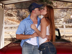 A redhead is on top of a car, getting her snatch rasnatched deeply