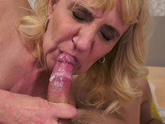 A blonde granny that loves cock is giving a blow job to her partner