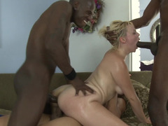 Three men are sticking their dicks into a hot blonde woman