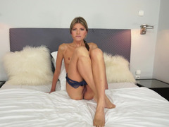 A tall bitch with small tits is fingering her juicy pussy lips
