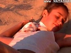 Natasha russian babysitter showing pink outside on the beach