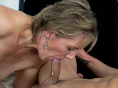 a granny that loves young men is getting her lips around a cock