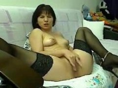 old onlineweb chat Maya in shoes intently fingering her vagina
