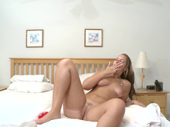 A sexy whore gets naked herself and additionally plays with her cunt on the bed